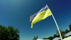 Flagstaff Ukrainian flag. Tapered flagpole at City Hall in Lviv with flag of Ukraine stock footage