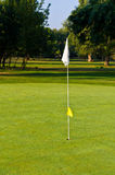 Flagstick. Is a marker used to indicate the position of the hole on a green Stock Photography