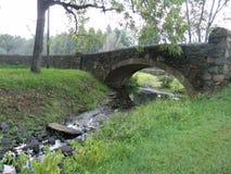 Flagstone bridge. Bridge over a river Royalty Free Stock Images