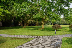 Flagstone path across verdant lawn Royalty Free Stock Photos