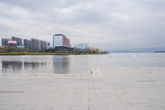 Flagstone paved lakeside in cloudy winter afternoon,Tianfu New A. Flagstone paved lakeside in cloudy winter afternoon at Tianfu New Area,Chengdu,China royalty free stock photos