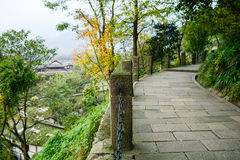 Flagstone pavement with chained stone balusters on mountainside Royalty Free Stock Photography
