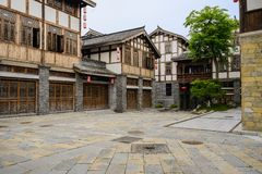 Flagstone street before old-fashioned tile-roofed buildings in c. Loudy afternoon,Qingyan town,Guiyang,China stock photo