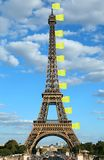 Flahd made with jackets symbol of Yellow vests movement on Eiffe. Flags like made with jackets symbol of Yellow vests movement on Eiffel Tower in Paris France royalty free stock photo
