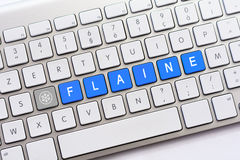 FLAINE writing on white keyboard with a snowflake sketch Royalty Free Stock Photography