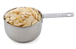Flaked almonds presented in an American metal cup measure Stock Image
