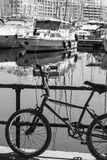 Bicycle on the embankment of Malta. Flaked bicycle on the embankment of Valletta. Yachts docked at the port of Malta. Black and white picture Royalty Free Stock Photography