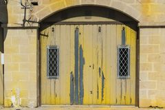 Flaked gate on Malta. Flaked gate in historic part of Valletta. Entrance to an abandoned house on the island of Malta Royalty Free Stock Images