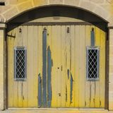 Flaked gate on Malta. Flaked gate in historic part of Valletta. Entrance to an abandoned house on the island of Malta Royalty Free Stock Photography
