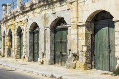 Flaked gates on Malta. Flaked gates in historic part of Valletta. Entrance to an abandoned house on the island of Malta Royalty Free Stock Photography