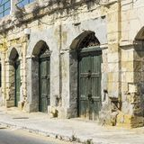 Flaked gates on Malta. Flaked gates in historic part of Valletta. Entrance to an abandoned house on the island of Malta Royalty Free Stock Photo