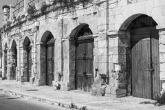 Flaked gates on Malta. Flaked gates in historic part of Valletta. Entrance to an abandoned house on the island of Malta. Black and white picture Stock Image