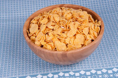 Flakes in bowl. Flakes in a wooden bowl Royalty Free Stock Image