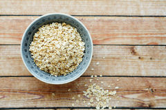 Flakes in a bowl on wooden background Royalty Free Stock Images