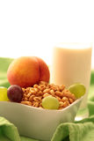 Flakes for breakfast. Flakes with fruits and milk Royalty Free Stock Photo