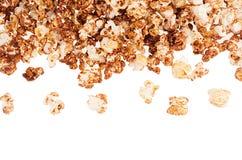 Flakes chocolate popcorn flying on white background, top view, isolated. Flakes chocolate popcorn flying on white background, top view, isolated Stock Photo