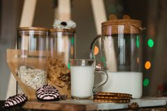 Flakes and cup of milk for breakfast. Concept of healthy food. Warm toning image. Rustic styling Royalty Free Stock Photography