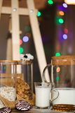 Flakes and cup of milk for breakfast. Concept of healthy food. Warm toning image. Rustic styling Stock Images