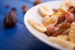 Flakes with dried fruit, granola on the plate Royalty Free Stock Image