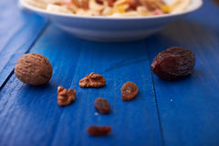 Flakes with dried fruit, granola on the plate Royalty Free Stock Photography