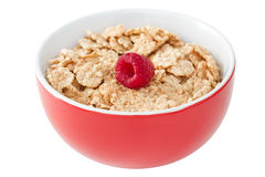 Flakes with raspberries in bowl Royalty Free Stock Image