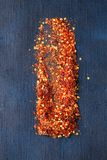 Flakes of red hot chili peppers Stock Image