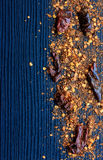Flakes of red hot chili peppers on wood background Royalty Free Stock Photography