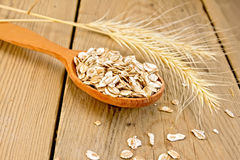Flakes rye in spoon on board Stock Image