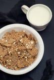 Flakes in white bowl on black background royalty free stock photo