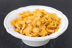 Flakes in white dish Stock Image