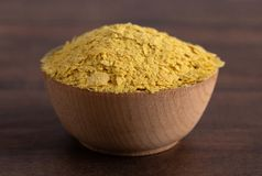 Flakes of Yellow Nutritional Yeast a Cheese Substitute and Seasoning for Vegan Diets royalty free stock images