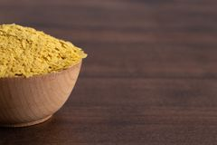 Flakes of Yellow Nutritional Yeast a Cheese Substitute and Seasoning for Vegan Diets royalty free stock photo
