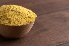 Flakes of Yellow Nutritional Yeast a Cheese Substitute and Seasoning for Vegan Diets stock photo