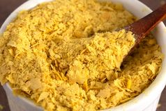 Flakes of Yellow Nutritional Yeast a Cheese Substitute and Seasoning for Vegan Diets stock image