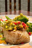 Flakey Chilaean Sea Bass Oceanside. Grilled Sea Bass Dinner Topped with Guacamole Relish - ocean in background Stock Images