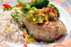 Flakey Chilaean Sea Bass Rice & Veg 2. Grilled Sea Bass Dinner Topped with Guacamole Relish Royalty Free Stock Photo