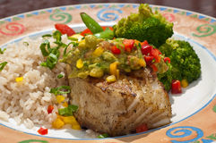 Flakey Chilaean Sea Bass Rice & Veg. Grilled Sea Bass Dinner Topped with Guacamole Relish Stock Photos