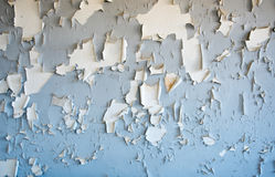 Flaking blue cracked paint on a wall Royalty Free Stock Photo