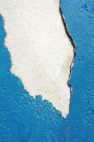 Flaking cement. Flaking blue cement on a white wall creates an irregular copy space Stock Photography