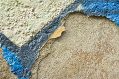 Flaking coloured plastering Stock Images