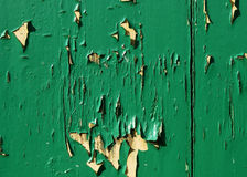 Flaking green paint. Green paint flaking on wood Stock Image