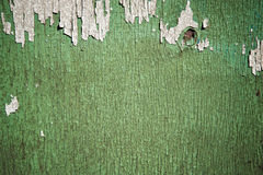 Flaking Green Paint on Faded Wood Background Royalty Free Stock Photo