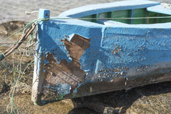 Flaking paint on a Canaries dingy. Flaking paint on a dingy in the well protected small boat harbour of Arrecife, Las Palmas, Spain royalty free stock images