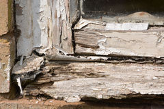 Flaking paint from a rotting wooden window frame Stock Photos