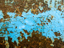 Flaking paint on rusty iron Stock Photos