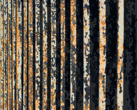 Flaking paint on rusty metal fence, perspective view.  Stock Photography