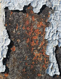 Flaking paint on rusty metallic surface Stock Photography