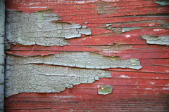 Flaking paint on a very old railway wagon side Royalty Free Stock Photo