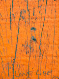 Flaking paint on weathered wood Stock Photos