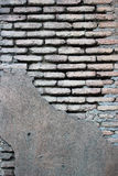 Flaking plaster on old grunge brick wall Royalty Free Stock Photo